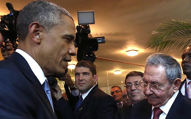 Cuban President Raul Castro and US President Barack Obama shake hands in Panama City.