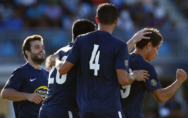 Auckland FC celebrate David Browne's penalty.