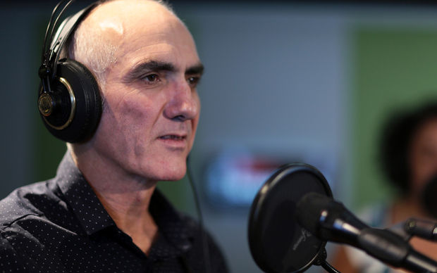 Singer-songwriter Paul Kelly performing at RNZ
