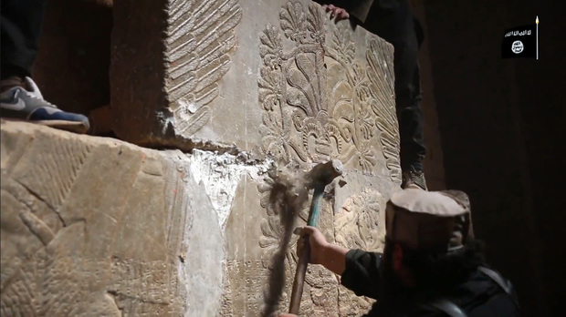 The video shows militants dismantling and destroying ancient stonework.