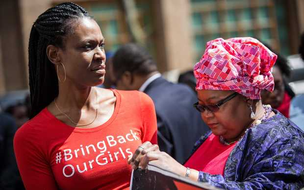 Women attend a rally bringing attention to the one year anniversary of the kidnapping of hundreds of Nigerian school girls on April 13, 2015 in New York City. The terrorist organization Boko Haram kidnapped more than 220 girls last year, many of whom remain missing.