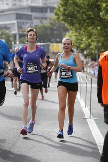 Melissa Moon guiding blind runner, Maria Williams in a half marathon in Wellington