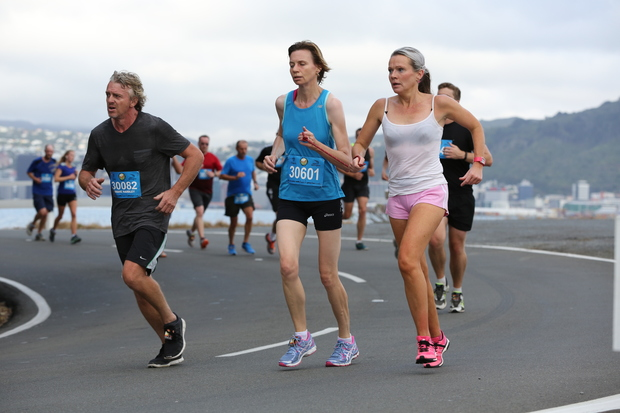 Melissa Moon guiding blind runner, Maria Williams during a round the bays race in Wellington