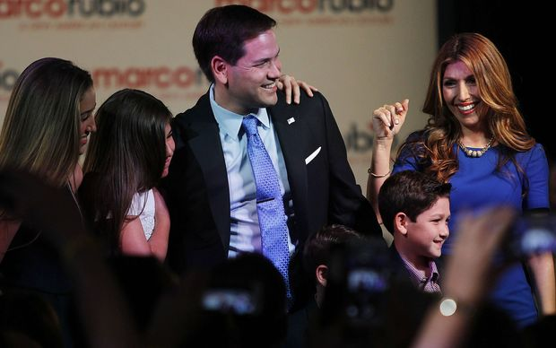 US Republican Senator from Florida Marco Rubio with his family after announcing his presidential candidacy on April 13, 2015 at The Freedom Tower in Miami