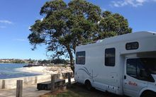A campervan at Takapuna Beach holiday park.