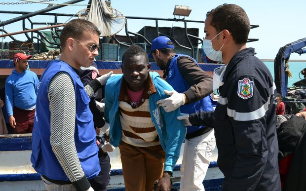 Migrants arrive at the port in the Tunisian town of Zarzis following the rescue.