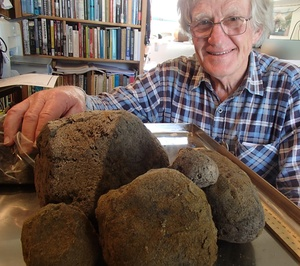 Archaeologist Bruce McFadgen with some of the pumice found in a thick layer in peat on the Kapiti Coast, which varies in size from 2 mm to 30 cm.