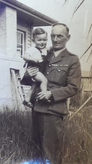 Ray, holding Rod as a baby.