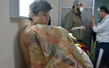 A young man at a clinic in the village of Sarmin following reports of suffocation cases related to an alleged regime gas attack in the area.
