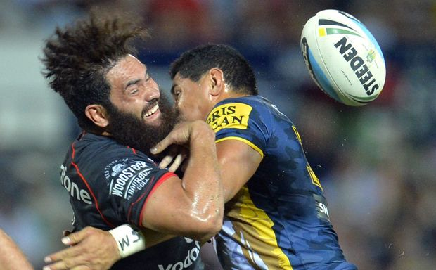 The Warriors' Konrad Hurrell loses the ball as the Cowboy's Jason Taumalolo makes a tackle.