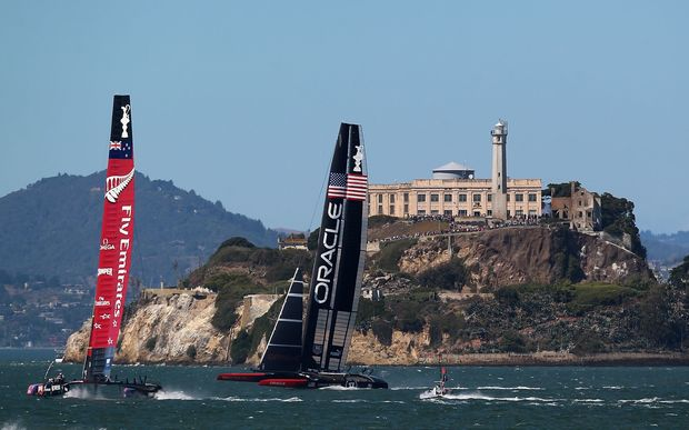 Emirates Team New Zealand and Oracle Team USA during the final race of the America's Cup Finals on September 25, 2013.
