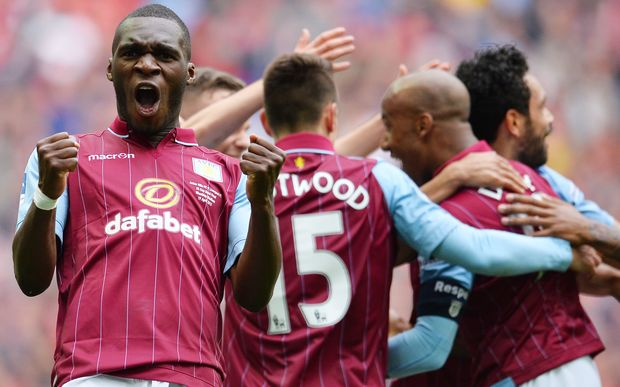 Aston Villa's Zaire-born Belgian striker Christian Benteke (L) celebrates Villa's second goal during the FA Cup semi-final between Aston Villa and Liverpool at Wembley stadium in London on April 19, 2015.