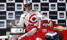 Scott Dixon with the spoils after winning the Indy Car Long Beach Grand Prix.