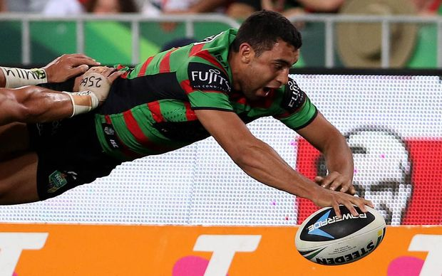 The Rabbitohs wing Alex Johnston dives over for a try.