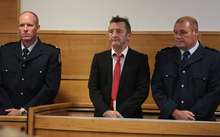 Phil Rudd (centre) at Tauranga District Court.