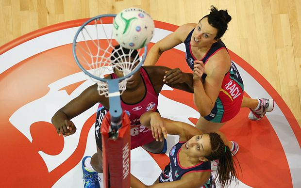 Southern Steel's Jhaniele Fowler-Reid, left, takes a shot at goal while Vixens Bianca Chatfield and Geva Mentor wait for a rebound.