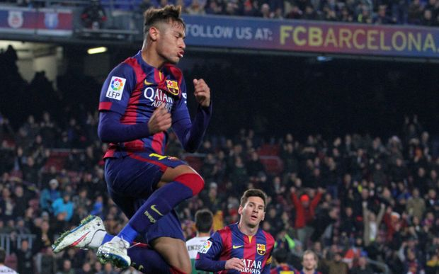 The Barcelona striker Neymar celebrates scoring a goal.