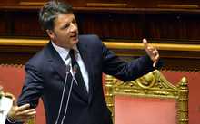 Italian Prime Minister Matteo Renzi gives a speech at the Upper House of Parliament in Rome on April 22, 2015, after observing a minute of silence in memory of the 800 migrants feared to have died when a boat packed with migrants capsized near Libya.