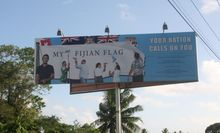 A billboard outside Vatuwaqa Primary School, authorised by the Fiji Government.