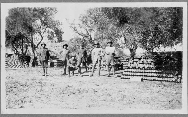 Rarotongan soldiers standing next to artillery shells, about 1916-18