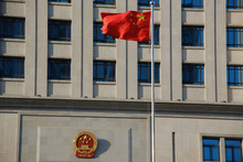A flag flies in front of a court house in Shangdong Province, China.
