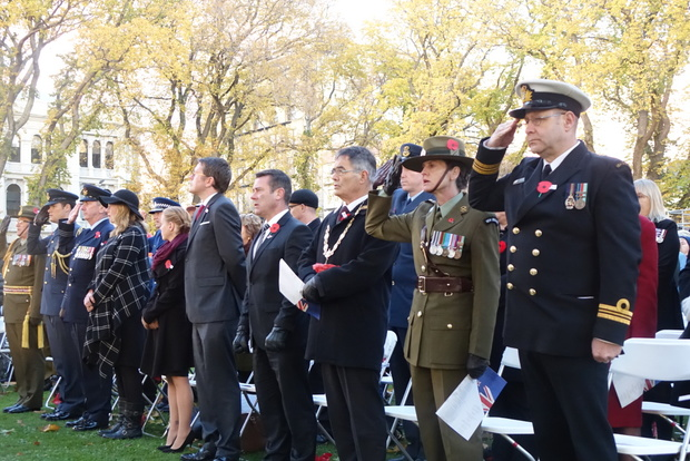 Guests salute to remember the fallen at the service in Dunedin.