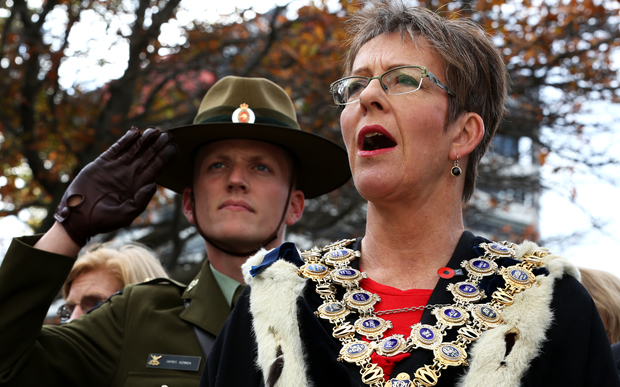 Wellington Mayor Celia Wade-Brown and a soldier paying their respects.