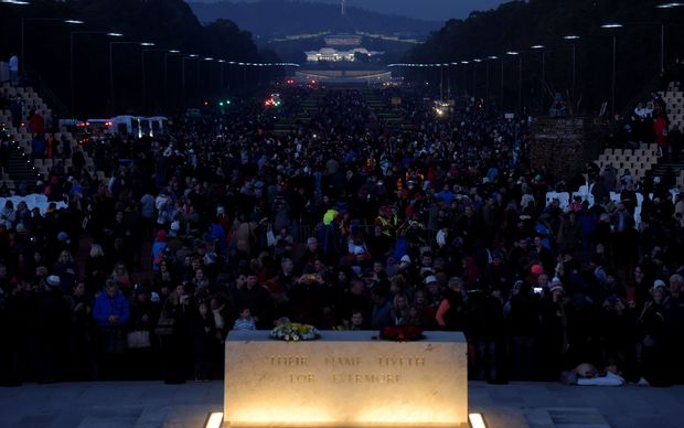 Thousands of people are seen near the stone of remembrance during the Anzac Day dawn service at the Australian War Memorial in Canberra, Saturday, April 25, 2015.