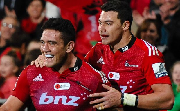 Codie Taylor of the Crusaders celebrates his try with team-mate David Havili.