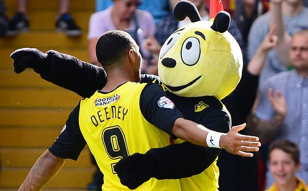 Watford's Troy Deeney celebrates with the club mascot after scoring.