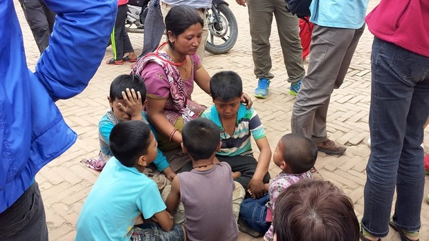 Children in Nepal are comforted following the earthquake.