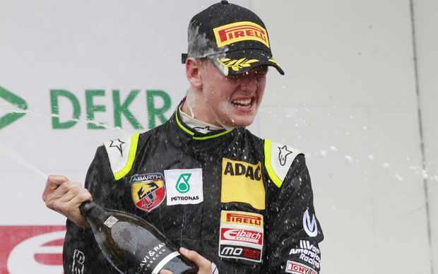 Mick Schumacher sprays champagne