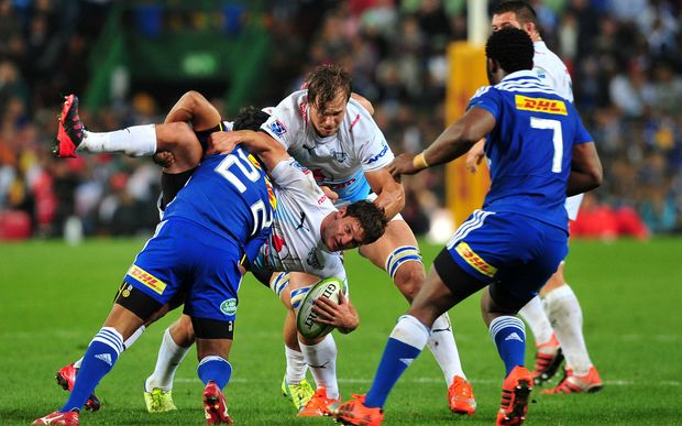 Piet van Syl of the Bulls is tackled by Kurt Coleman of the Stormers