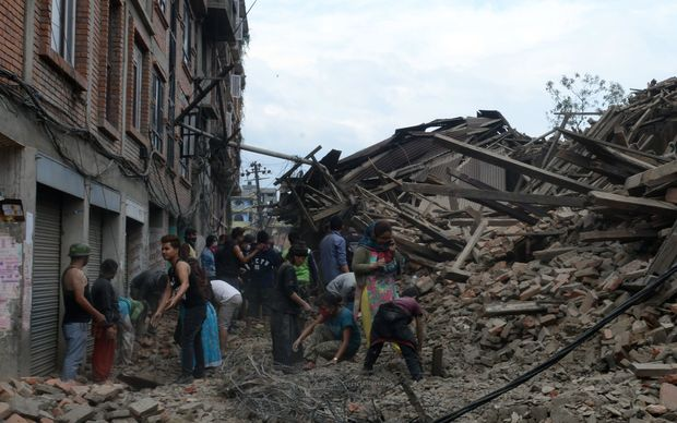 Rescuers in places used their bare hands to dig for survivors still buried underneath the rubble.