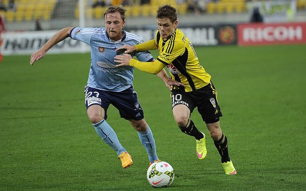 Wellington Phoenix midfielder Michael McGlinchey (right) battles for possession with Sydney FC defender Rhyan Grant.