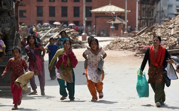 Nepalese residents following fresh tremors in Kathmandu.