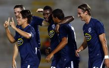 Auckland's Joao Moreira celebrates his goal with his team-mates.