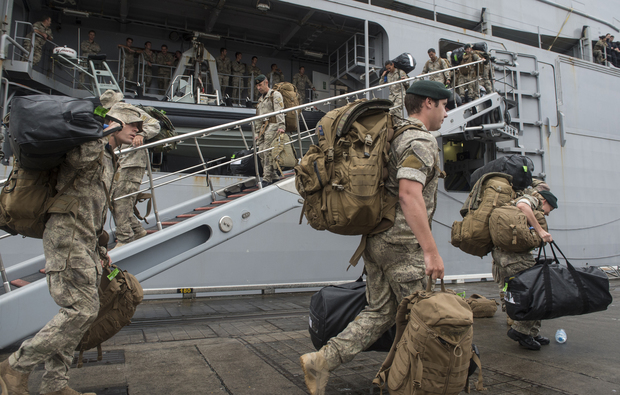 Army personnel disembark from the HMNZS Canterbury.