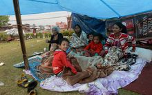 A Nepalese family in a makeshift shelter.