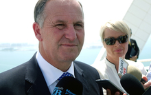 Prime Minister John Key speaks to reporters on the helipad of the Burj Al Arab, the world's only 7 star hotel.