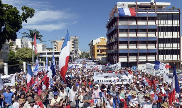 People take part in a demonstration on April 24, 2015 in Noumea, New-Caledonia, called by two right wing UMP affiliated parties to codemn the French Governemnt policy about New-Caledonia forced march towards independance.