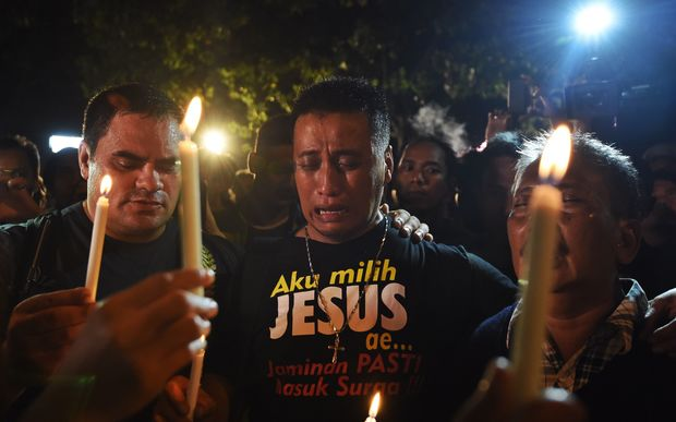 Christian anti-death penalty advocates held a vigil on Wednesday at the port opposite Nusakambagan prison island.