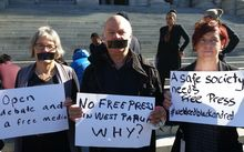 Protestors calling for open access for media and aid groups to West Papua gather outside parliament in Wellington.