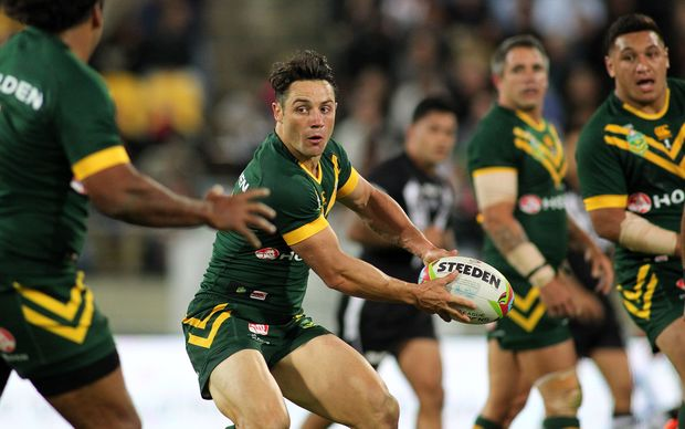 Cooper Cronk passes with Corey Parker watching on.