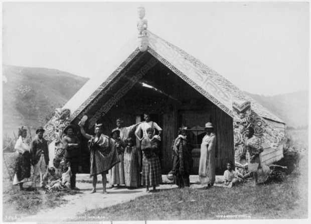 An unidentified Maori group in front of the Hinemihi meeting house at Te Wairoa in the 1880s.