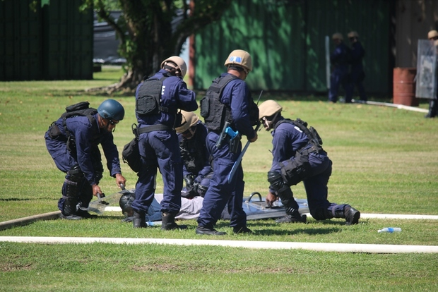 Solomon Islands Police put on public order management demonstration at GBR RAMSI base.
