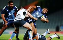 The Blues' Charles Piutau tries to escape tacklers