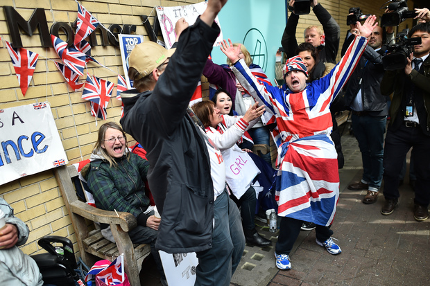 Royal fans are surrounded by media as they celebrate following the announcement of the birth of Catherine, Duchess of Cambridge and Prince William's second child, a daughter, outside the Lindo wing at St Mary's hospital in central London.
