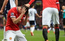 Patrick McNair of Manchester United looks dejected.