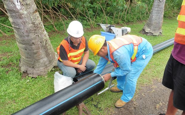 Contractors work on the Te Mato Vai water project in Rarotonga, Cook Islands